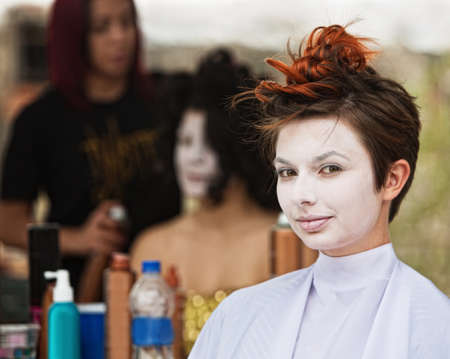 hair stylist: Young female actress in white make up sitting