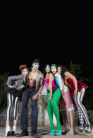 Group of five cirque clowns on stage photo