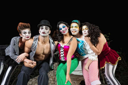 Group of character clowns posing on stage Stock Photo