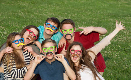 disguised: Happy group of five teenagers in silly costume