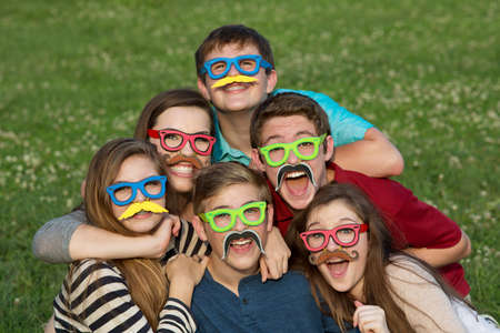 disguised: Five teenage male and females in mustache disguise