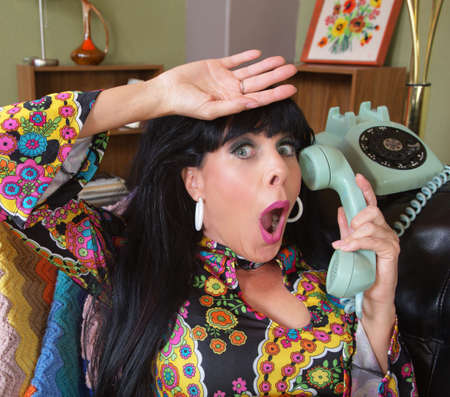 relieved: Relieved woman in paisley on rotary telephone