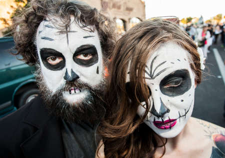 mature mexican: TUCSON, AZUSA - NOVEMBER 09: Two unidentified people in dramatic facepaint at the All Souls Procession on November 09, 2014 in Tucson, AZ, USA.