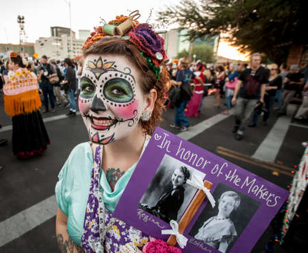 tucson: TUCSON, AZUSA - NOVEMBER 09: Unidentified woman with memorial sign in facepaint at the All Souls Procession on November 09, 2014 in Tucson, AZ, USA. Editorial