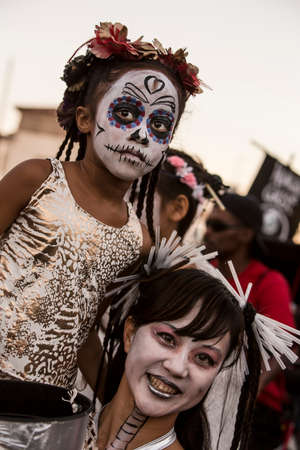 TUCSON, AZUSA - NOVEMBER 09: Unidentified woman and young girl in facepaint at the All Souls Procession on November 09, 2014 in Tucson, AZ, USA.