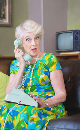 obscenity: One surprised woman in conversation rotary telephone