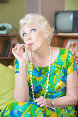 middle joint: Senior lady high from smoking weed in 1960s scene