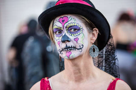 sugar veil: Serious female in hat with makeup for Dia De Los Muertos Stock Photo