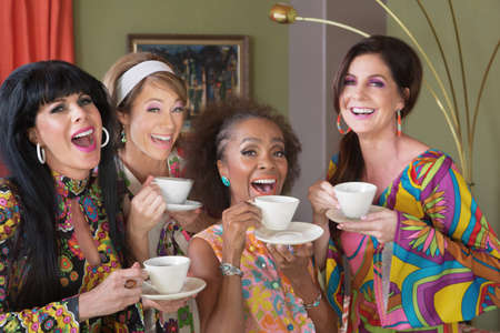 Laughing group of four women in retro style 版權商用圖片