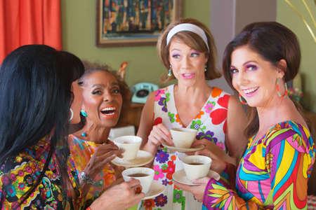 Cute group of retro style women drinking tea Standard-Bild
