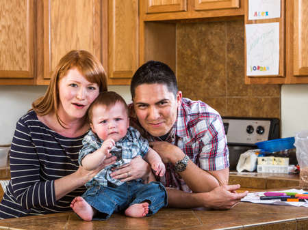 Family spending time together in kitchen photo