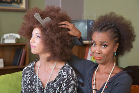 unimpressed: White woman with afro wig and unimpressed friend