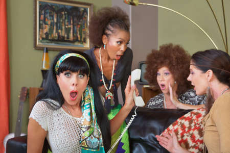 answering call: Group of four retro ladies listening to telephone