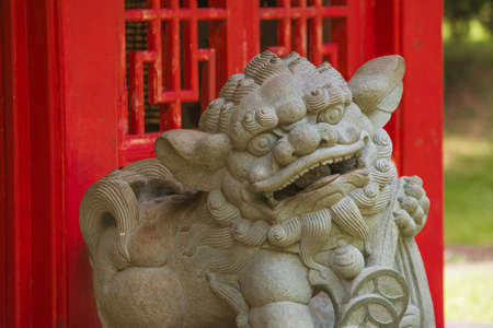 Chinese Guardian Lion in Front of Red Structure