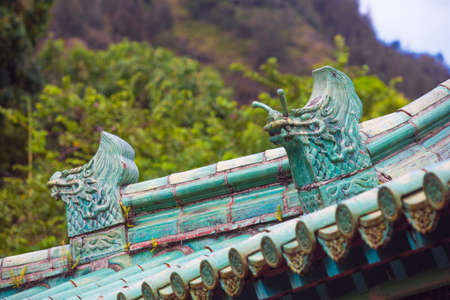 architectural details: Two Chinese Rooftop Dragon Architectural Details