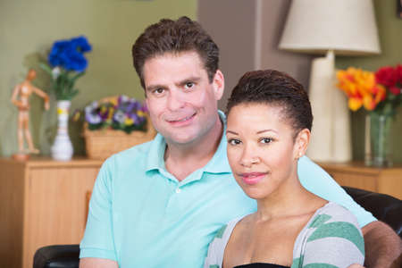 wife and husband: Attractive smiling male and female couple sitting together