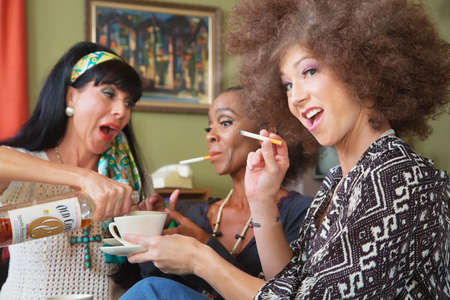 substance abuse: Laughing women smoking cigarettes and drinking alcohol