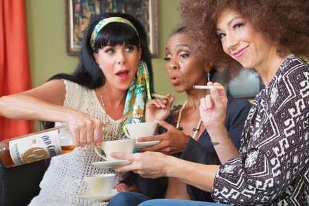 teacups: Drunk woman tempting friends with whiskey in teacups
