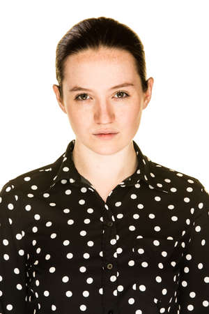 deadpan: An irritated young girl on a white background