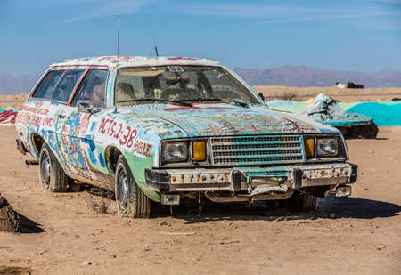 avant: CALIPATRIA, IMPERIAL COUNTY, CALIFORNIA, USA - NOVEMBER 28: Bible car outsider art installation at Salvation Mountain on November 28, 2014 in at Calipatria, California, USA.