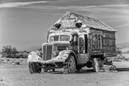 avant: CALIPATRIA, IMPERIAL COUNTY, CALIFORNIA, USA - NOVEMBER 28: Black and white rendering of Bible truck outsider art installation at Salvation Mountain on November 28, 2014 in at Calipatria, California, USA.