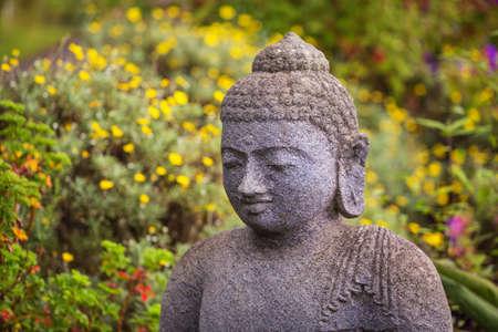 buddah: Close up of grinning stone Buddah statue