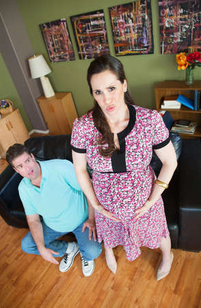 contractions: Scared Caucasian husband with pregnant woman having contractions