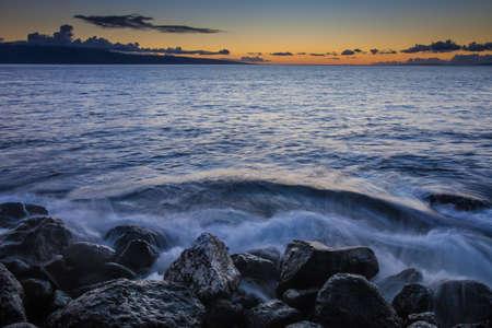 crashing: Waves crashing into beach on Maui Hawaii