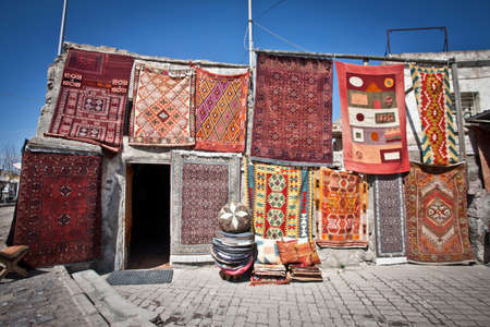 Colorful Turkish rugs being sold in a market