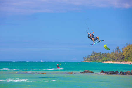 kiter: KAHULUI, HI USA - AUGUST 30: California kite surfer Robert Blum practicing off Kanaha Beach on August 30, 2014 in Kahului, Maui, USA. Editorial
