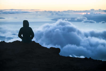 Watching sunset above Maui clouds from Haleakala photo