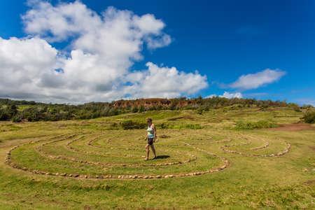 labyrinth: Woman doing walking meditation in labyrinth near Dragons Teeth Stock Photo