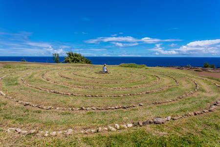 Person meditating in stone labyrinth near Dragons Teeth photo