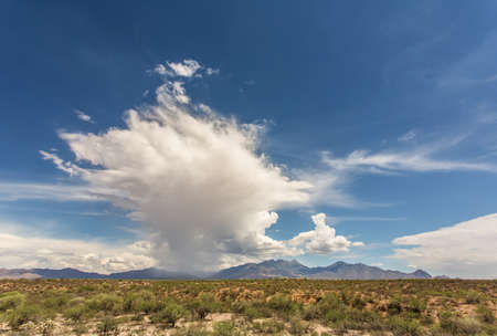 monsoon clouds: Rain storm build up near mountain in Arizona desert Stock Photo
