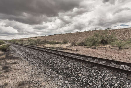 single line: Single line of railroad tracks in Arizona desert Stock Photo