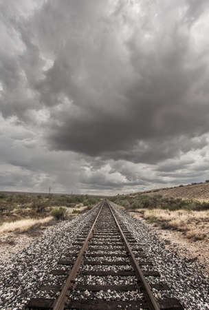 monsoon clouds: Single railroad track with monsoon clouds above