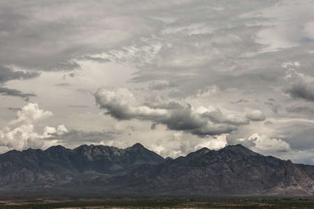 monsoon clouds: Cloudy summer monsoon forming around arizona  mountain Stock Photo