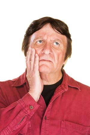dudando: Individual hombre perdido aislada con la mano en la mejilla Foto de archivo