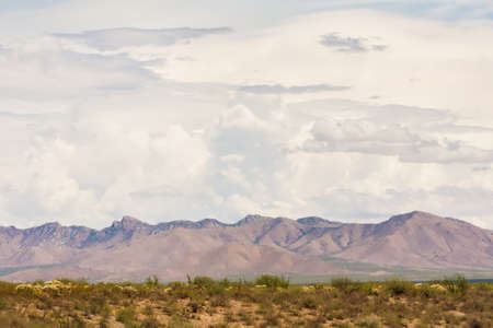 monsoon clouds: Thunderstorm clouds gathering above Arizona mountains in desert