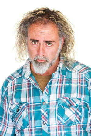 apologetic: Isolated disappointed man in flannel shirt over white Stock Photo