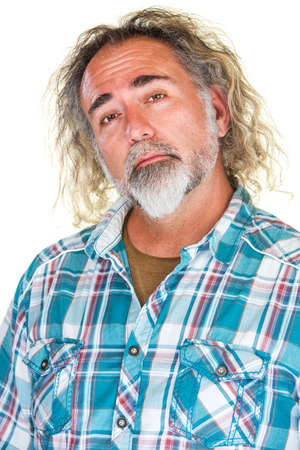 snob: Handsome mature man with beard and long hair Stock Photo