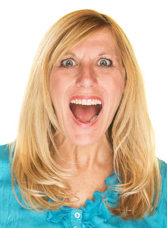 hysterical: Close up of excited middle aged woman laughing Stock Photo