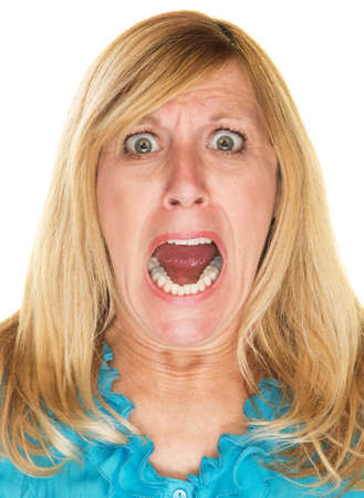 Single isolated blond woman screaming over white background Stock Photo