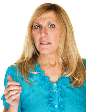 uncomfortable: Uncomfortable blond mature female with worried expression