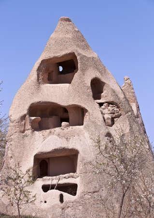 Uninhabited historic Turkish sandstone cave home in Cappadocia Stock Photo
