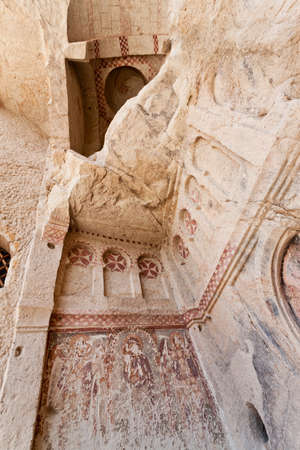 defaced: Goreme church remains with historic vandalism in Cappadocia Turkey Stock Photo