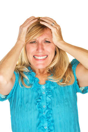 holding on head: Helplessly frustrated European female holding head Stock Photo