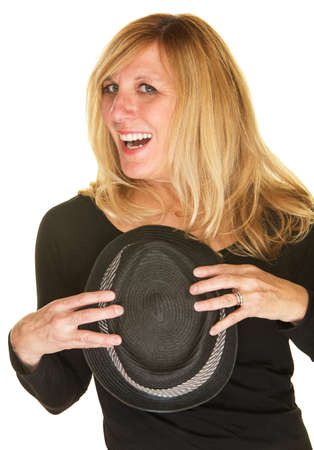 beautiful middle aged woman: Beautiful middle aged singer holding black hat