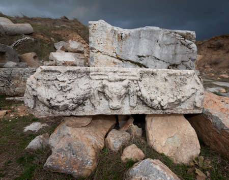 carved stone: Carved stone piece with ram and graland at Antioch Pisidian in Turkey Stock Photo