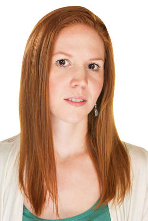 apprehensive: Isolated skeptical young Caucasian female with red hair Stock Photo